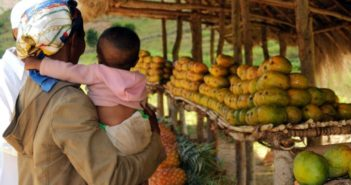 female-holding-her-child-in-her-arms-on-farmer-market-in-farafangana-madagascar-725x485