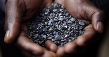SOUTH KIVU PROVINCE, CONGO - APRIL 28:  A Miner holds tantalum stones April 28, 2010 in Numbi in South Kivu Province, Democratic Republic of Congo. The long war, which had involved 9 African nations and claimed an estimated three million lives as a result of fighting or disease and malnutrition, was fuelled by the regions vast mineral wealth.  (Photo by Kuni Takahashi/Getty Images)